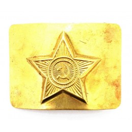 Belt buckle with a star made of brass